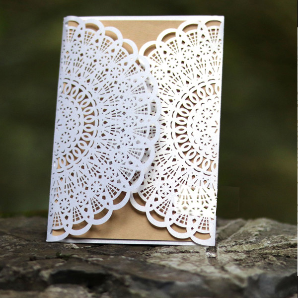 Vintage and classic white laser cut wedding invitations with suede ribbon  LC059