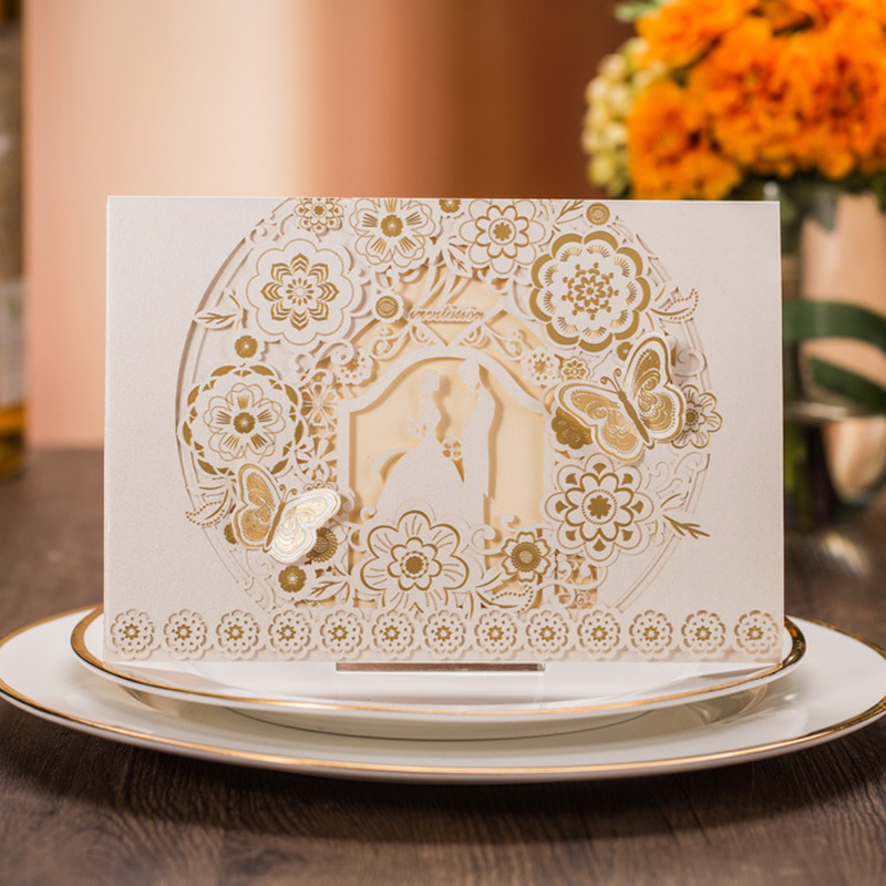 Gold and White Pocket Laser Cut Wedding Invitations Butterfiles and Bride and Groom in Silhouette