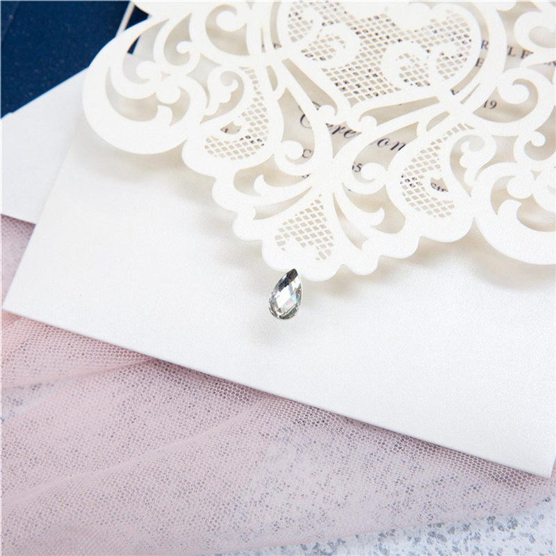 Intriguing Ivory Lace Laser Cut Wedding Invitations with Rhinestone and Navy Backer
